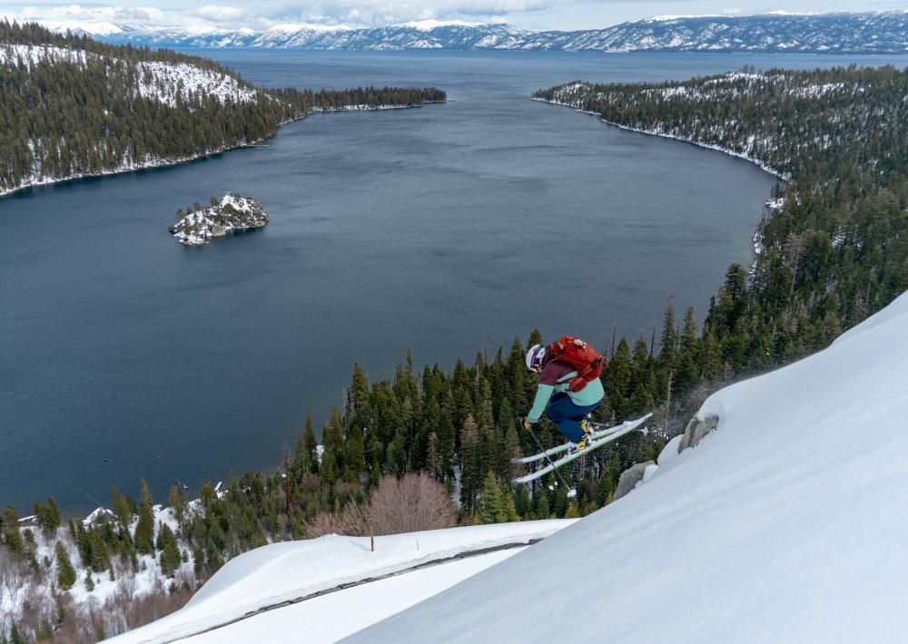 A person performing a jump while downhill skiing near Emerald Bay - Telemark Ski Bindings